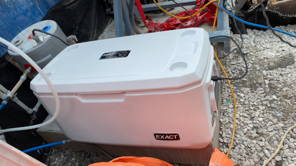 Field curing of concrete testing cylinders in a connected curing box from Exact Technology